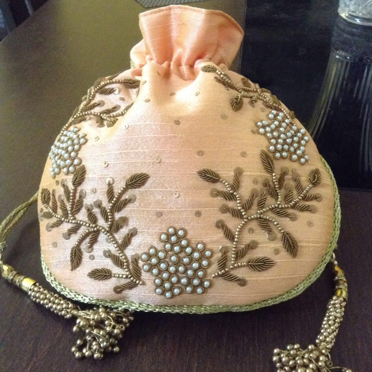 peach embroidered potli bag